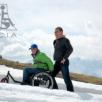 کاربر با ویلچر روی ماسه های کنار دریا کاربر با ویلچر روی برف در کوهستان